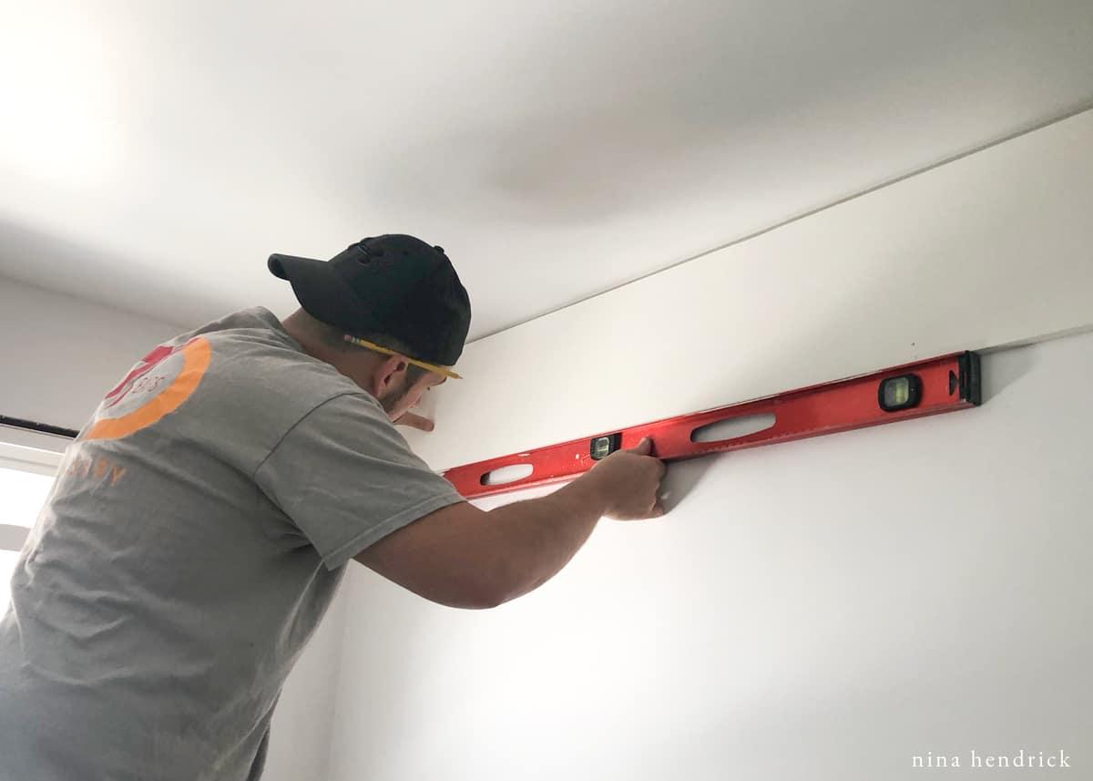 Checking Level for PVC Shiplap Wall