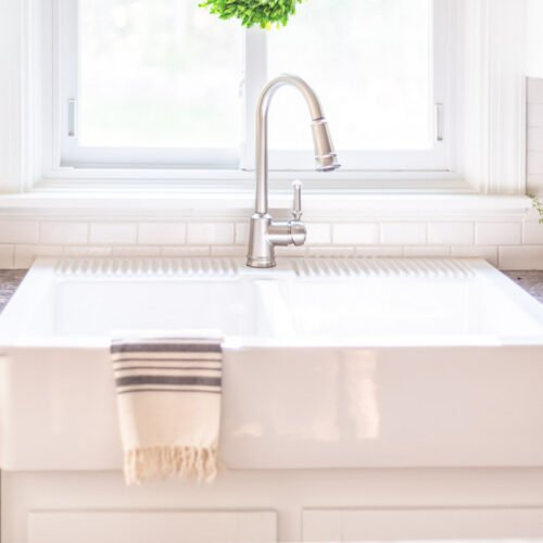 Ikea Farmhouse Sink Review | An honest review of the IKEA Farmhouse Sink (DOMSJÖ) with cleaning tips, installation questions answered, and whether or not it's holding up after a few years. Learn our pros and cons about this beautiful and affordable farmhouse sink!