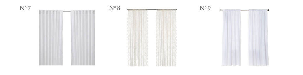 Stylish Budget Window Treatments | These drapes are light and airy and don't make your room darker. They are inexpensive curtain options with plenty of style.
