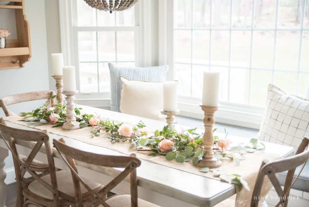 English garden inspired centerpiece in a breakfast nook with french x-back chairs