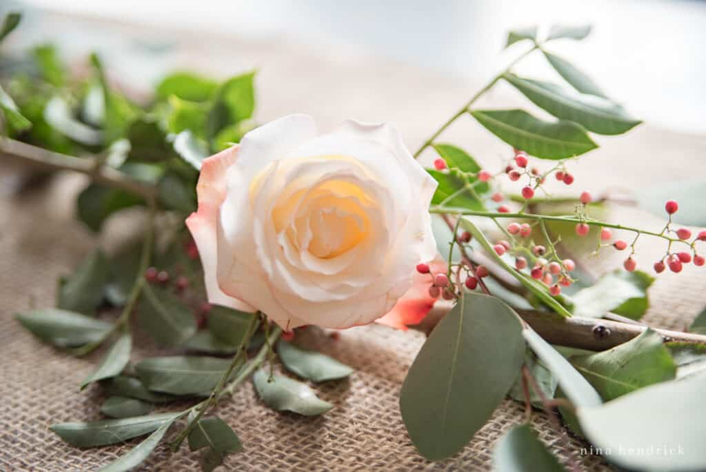 English rose and seeded eucalyptus centerpiece