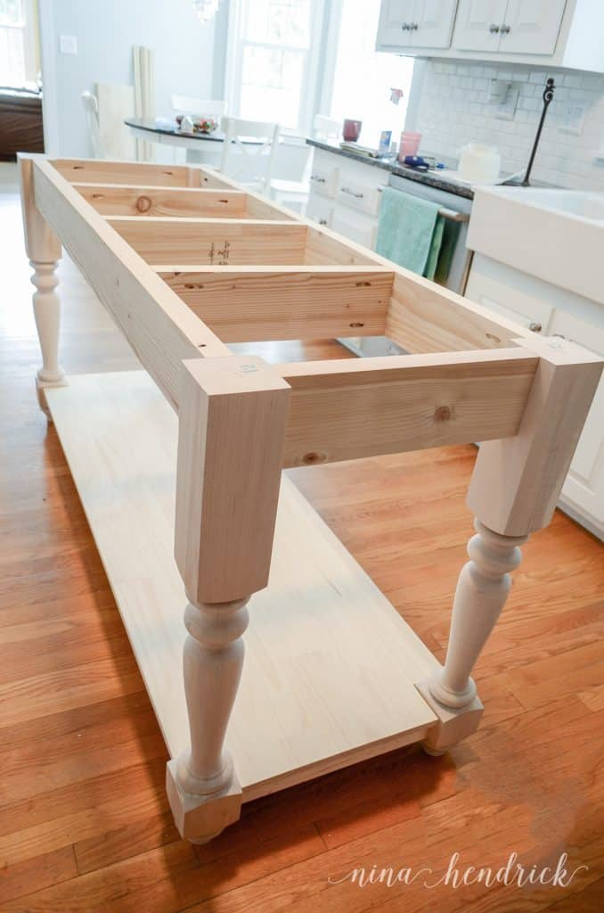 "Building a DIY kitchen island with 2x6"" lumber and turned legs"