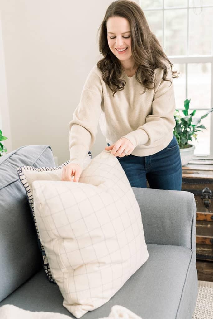 Nina Hendrick fluffing pillows