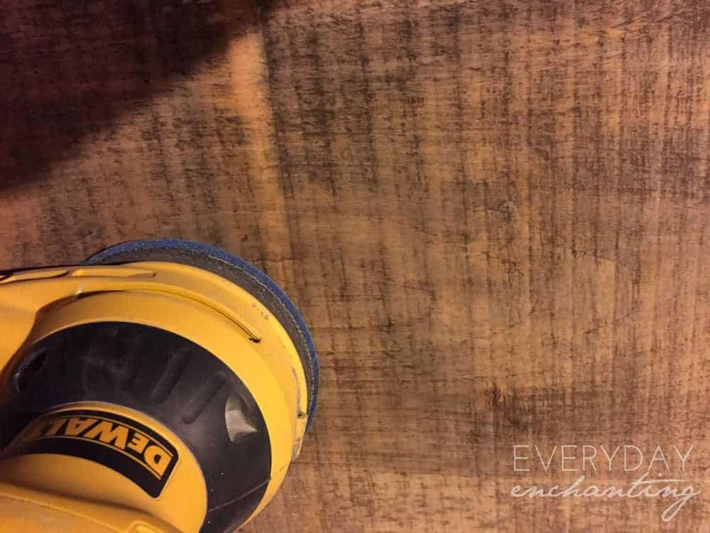 sanding wooden plank