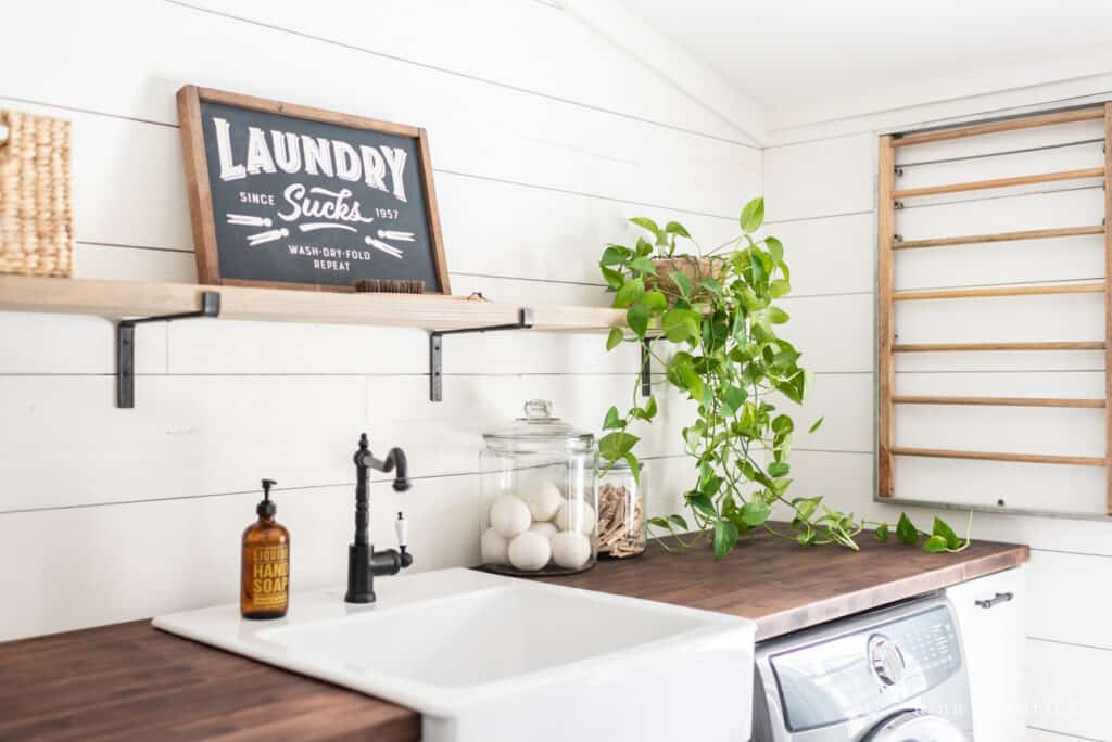 open shelving in the laundry room