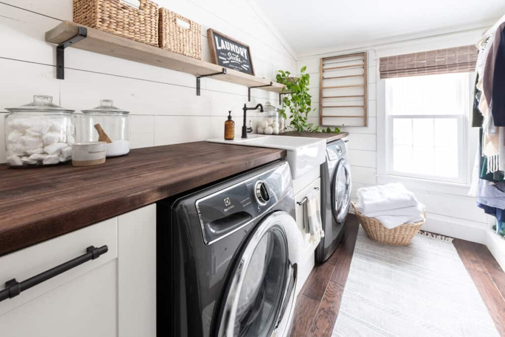laundry room makeover that shares space with an organized woman's closet