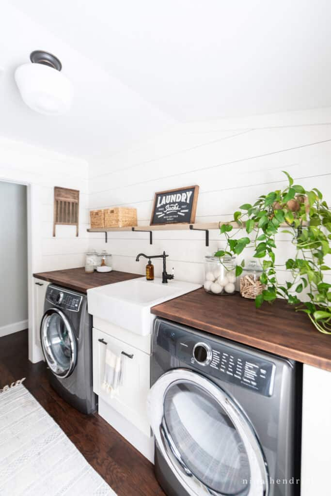 laundry room makeover with a laundry sucks sign