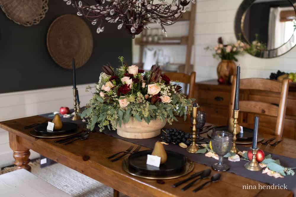 Moody fall tablescape with large abundant floral arrangement