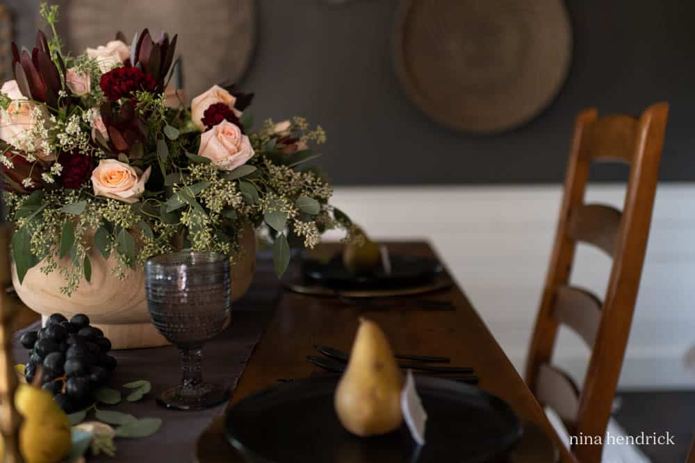 Rose floral arrangement with dark plates