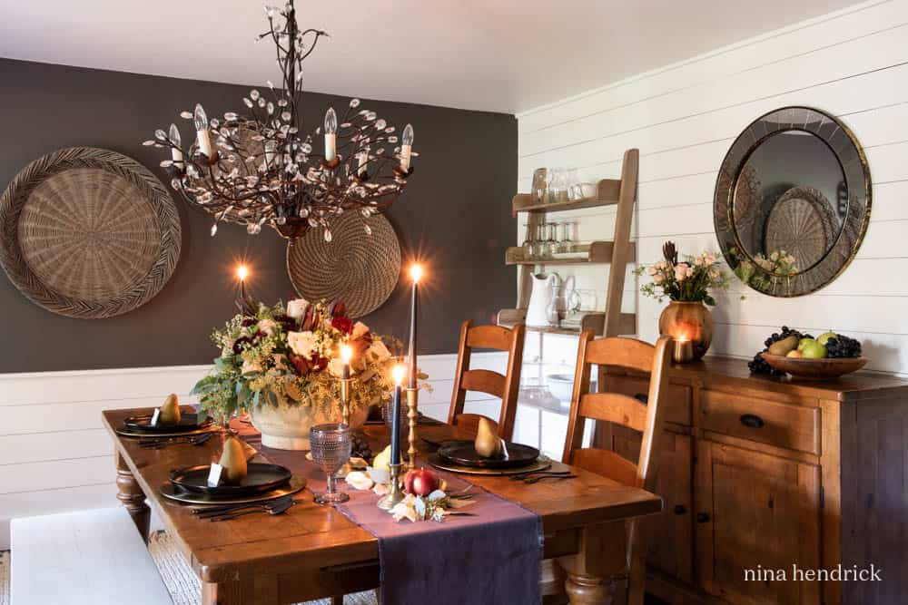 Dining Room decorated with a moody fall tablescape.