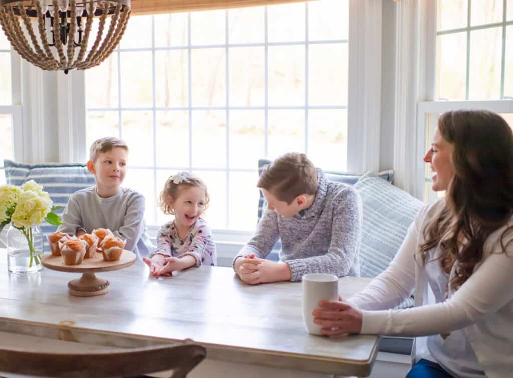 Family eating breakfast around a table as part of their morning routine