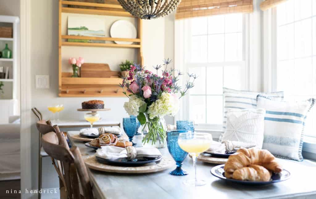 Tablescape with mimosas and blue glasses