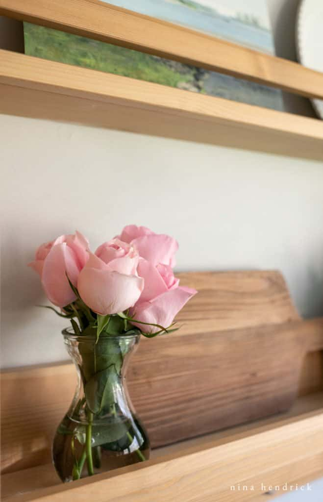rosebuds on a shelf
