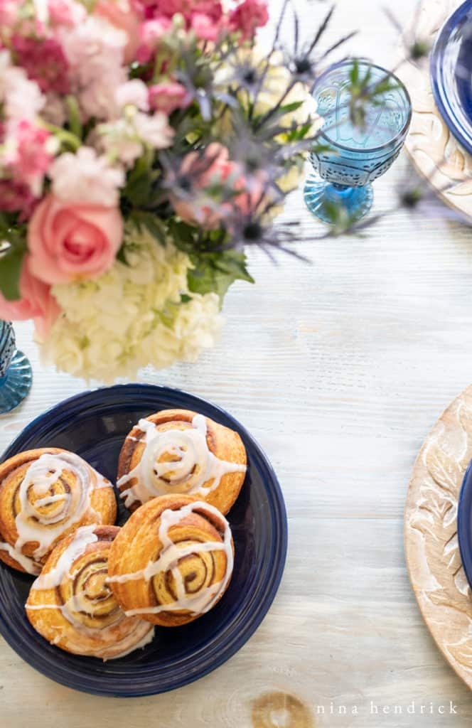 Flowers and cinnamon buns at a mother's day brunch