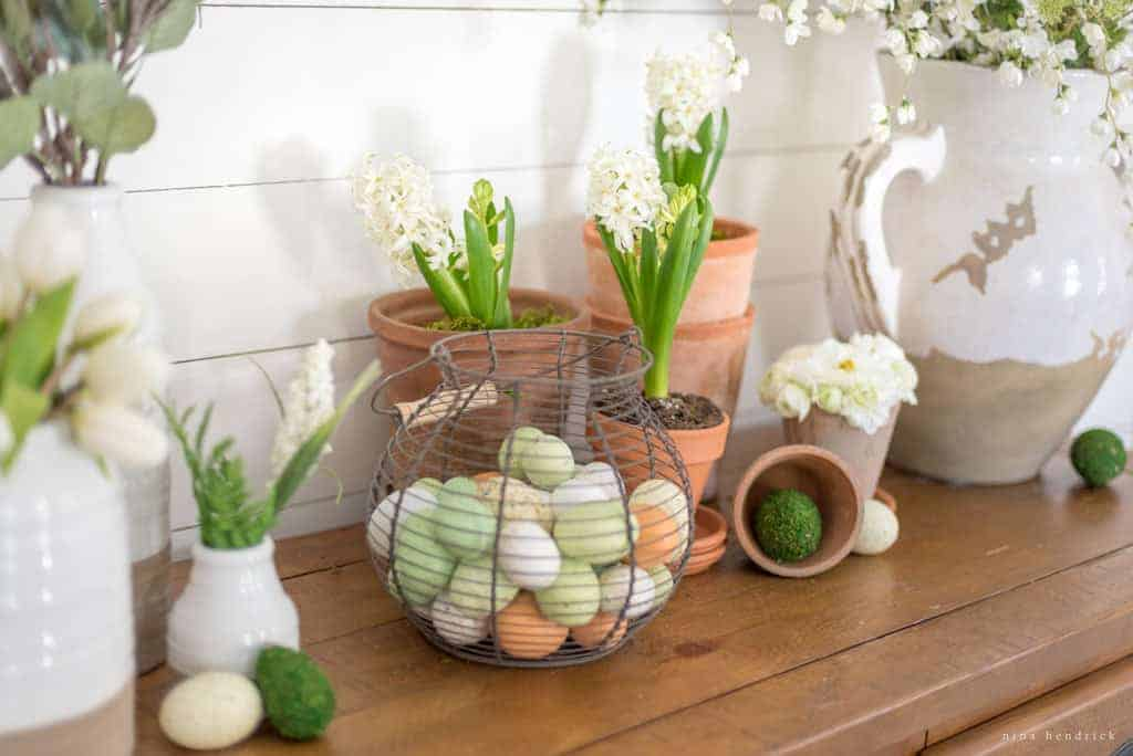 Natural Spring Tablescape   Recreate this natural spring tablescape for Easter using ferns, moss, eggs, flowers, and flowering branches!