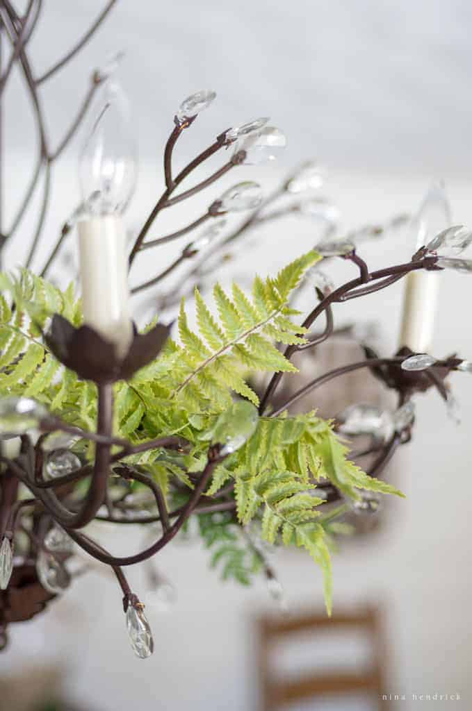 Natural Spring Tablescape   Recreate this natural spring tablescape and dining room vignette for Easter using ferns, moss, eggs, flowers, and flowering branches!