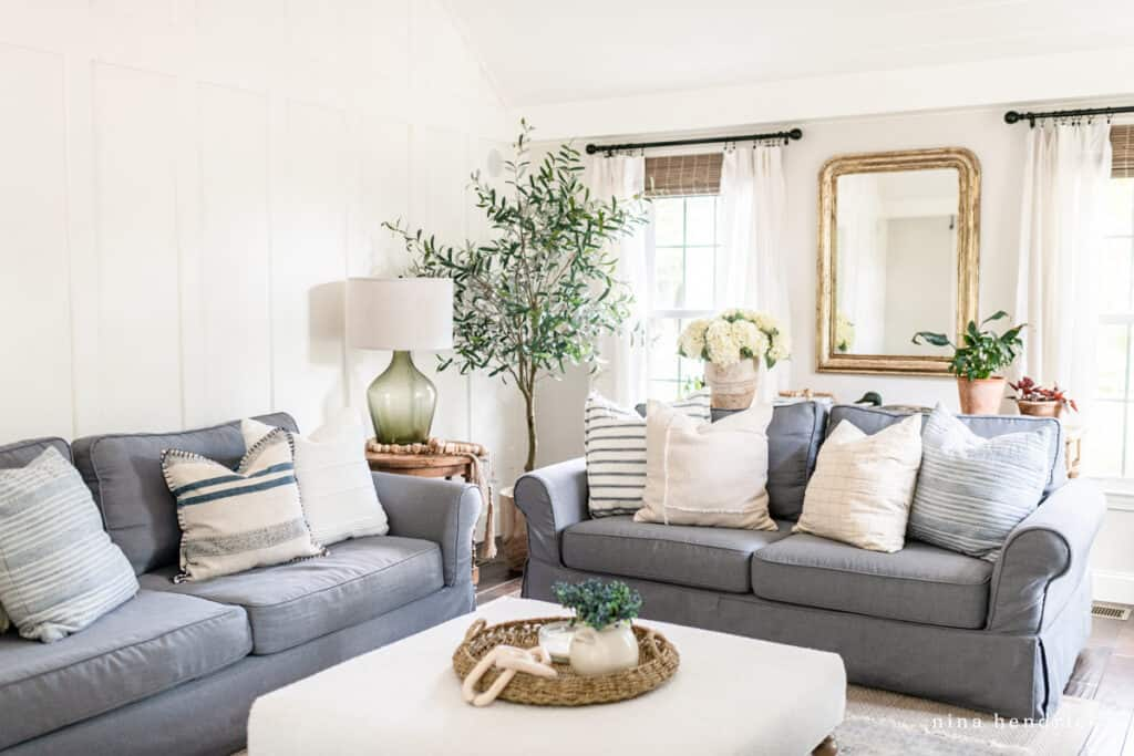 Family Room Makeover with gray slipcovered sofas