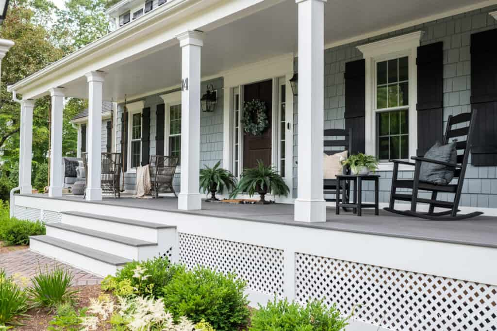 Porch with white columns and lattice in front of the garden