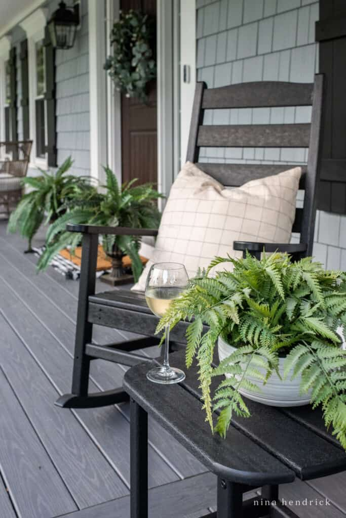 relaxing porch rocking chairs with a glass of wine