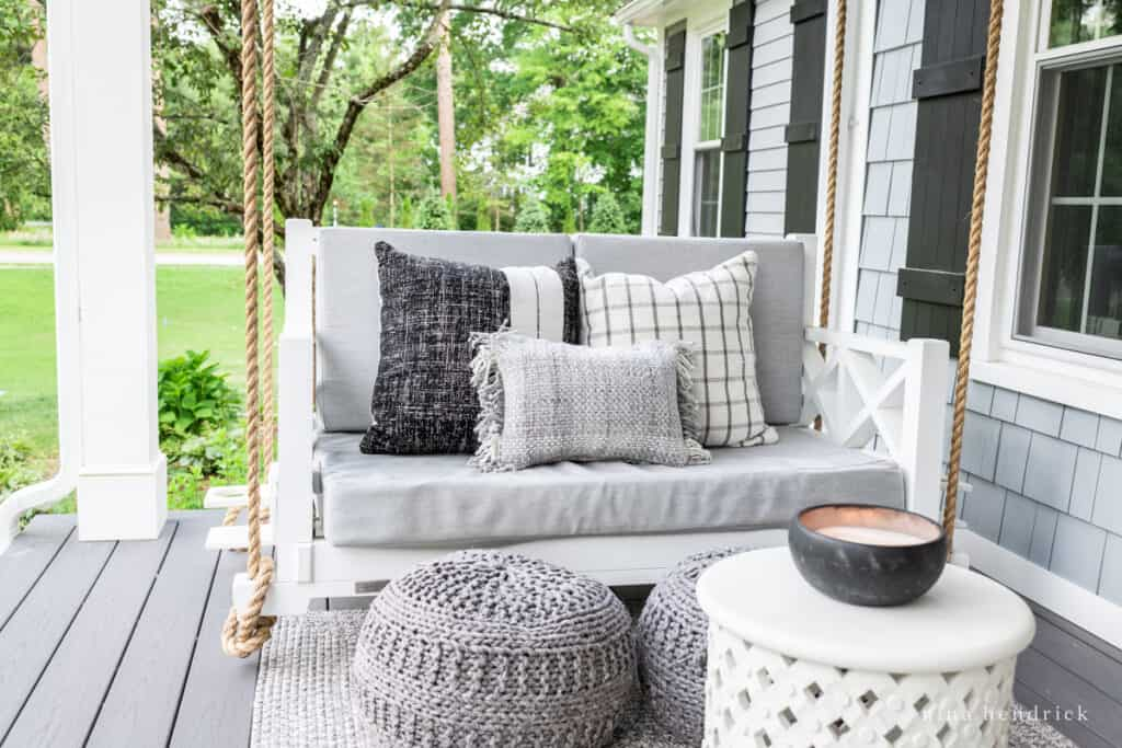 farmer's porch swing with outdoor pillows