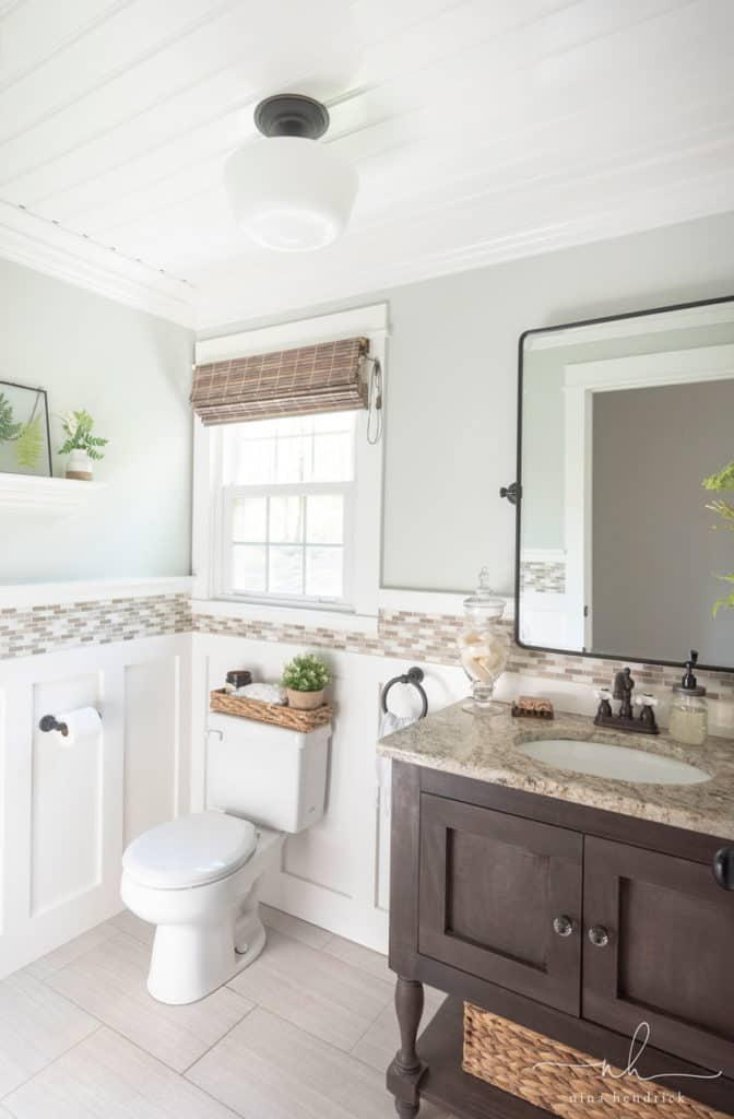 Cottage-style powder room with beadboard ceiling