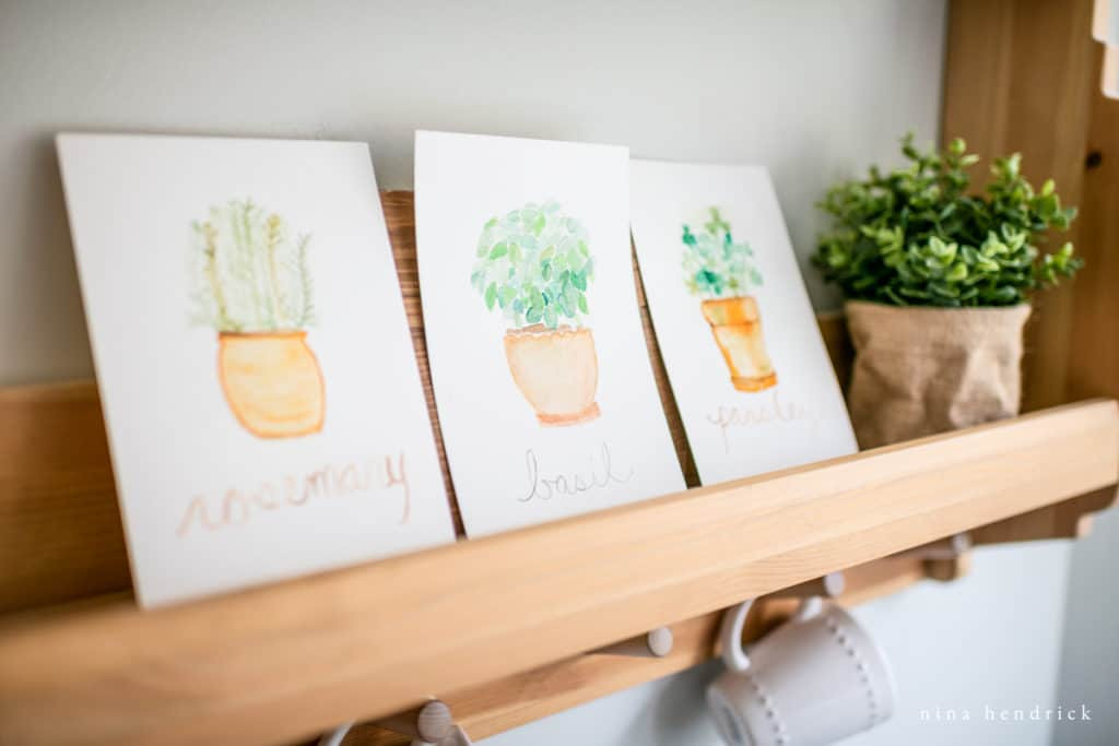 Potted Herb Watercolor Prints on a kitchen shelf