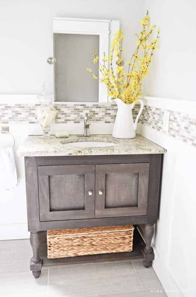 DIY Pottery Barn Inspired Sink Console |Learn how to build a DIY Pottery Barn Inspired Sink Console with this step by step vanity building tutorial.