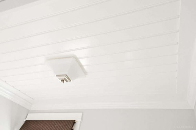 DIY Beadboard Ceiling Tutorial   Learn how to cover a dated texture ceiling with cottage style beadboard for a custom look.