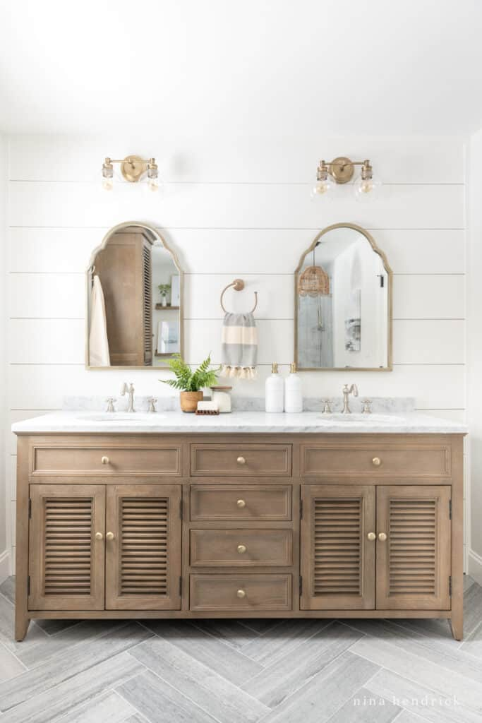 PVC planked wall painted simpy white with wood shutter bathroom vanity