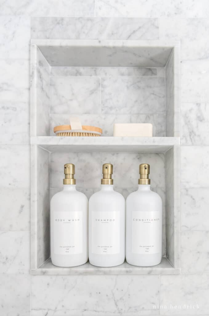 Shower niche with glass bottles and soap