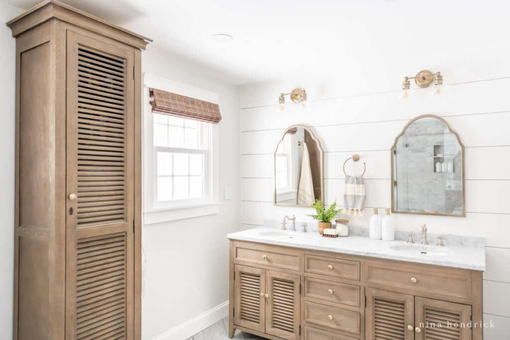 Wood cabinets in a classic primary bathroom remodel