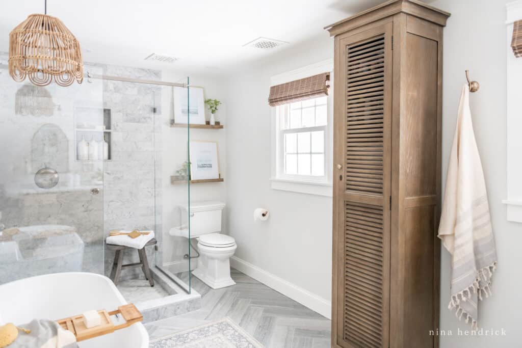 Primary Bathroom Makeover with rustic wood and herringbone floors