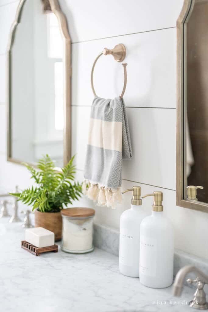 Soap and towel on a towel ring above a bathroom vanity