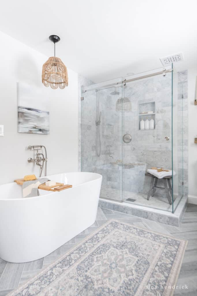 Primary bathroom renovation with a freestanding tub and glass shower surround with Benjamin Moore Paper White walls