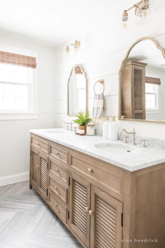 Primary Bathroom Makeover with a rustic wood vanity and coastal-inspired planked wall