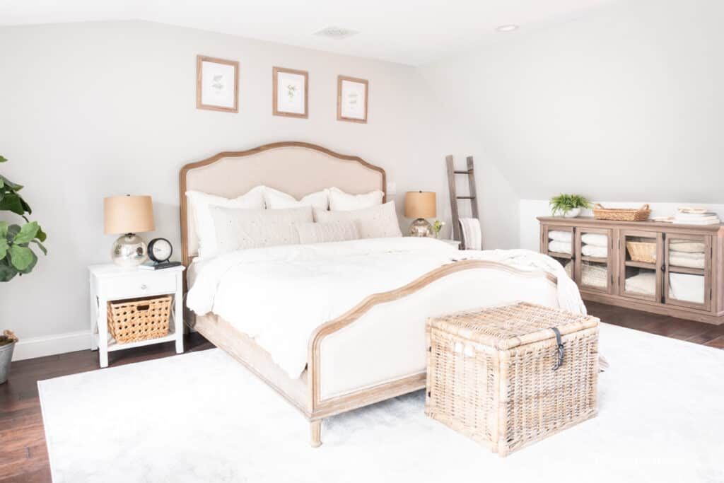 primary bedroom makeover with wood and upholstered bed