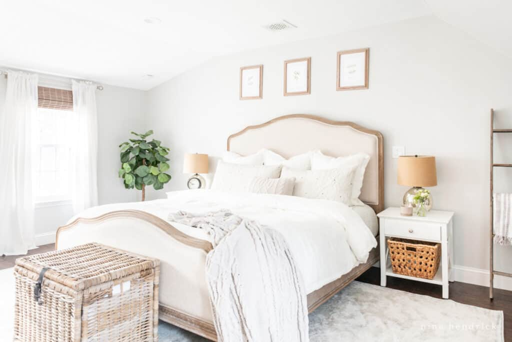 white nightstands with a wood & upholstered bed