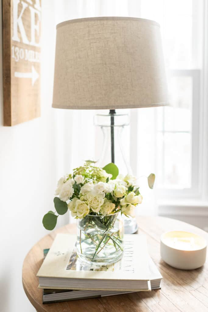 flowers and lamp on a side table