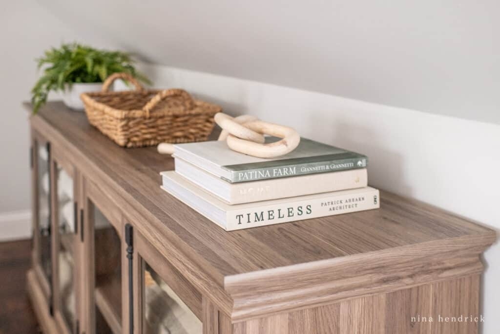 linen cabinet with decor books