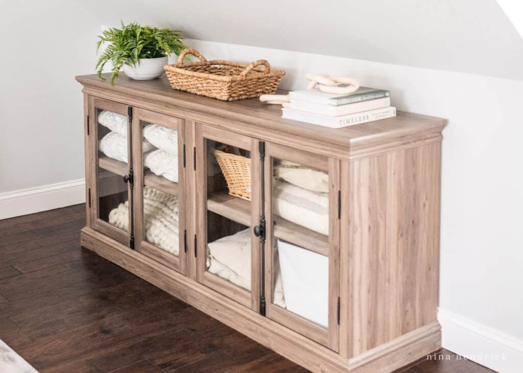 Storage solution for a sloping roof during a primary bedroom makeover: linen cabinet