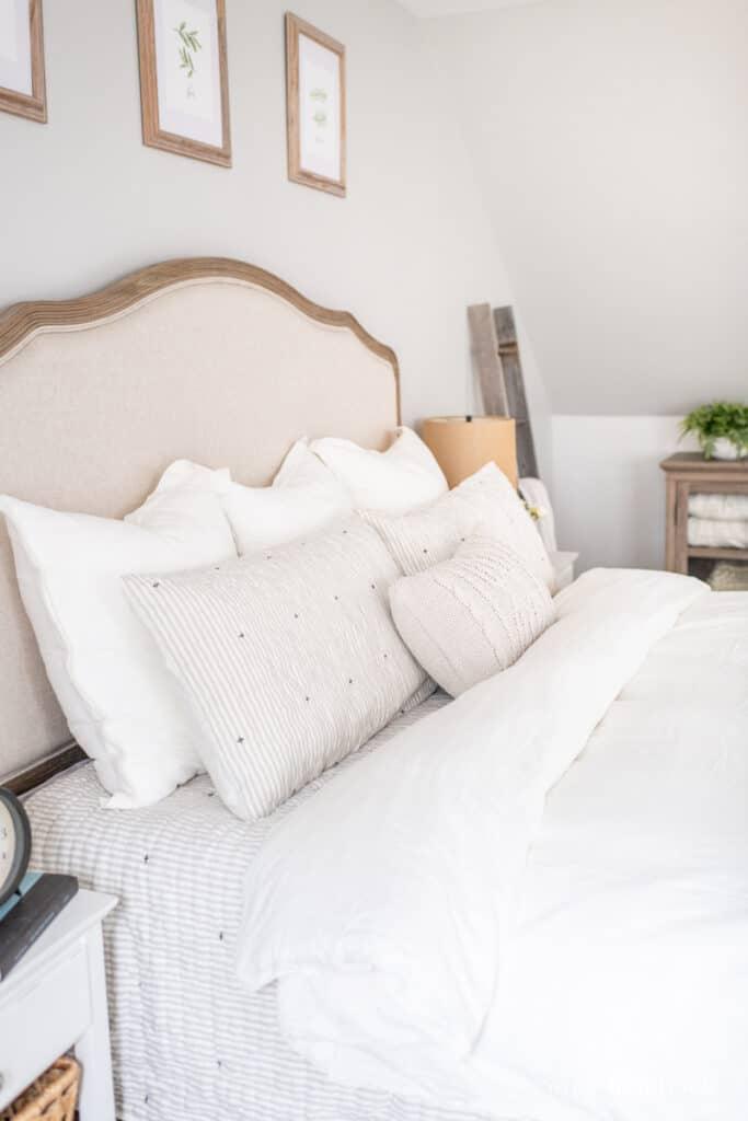 Neutral linen and ticking stripe bedding
