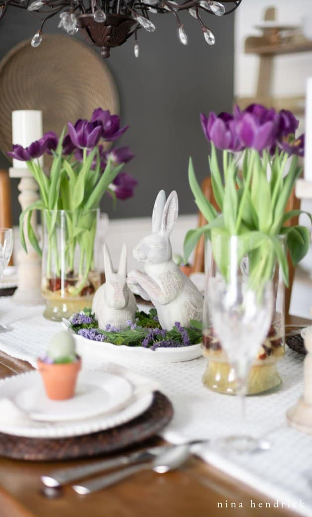 Purple spring tablescape with tulips and bunnies.
