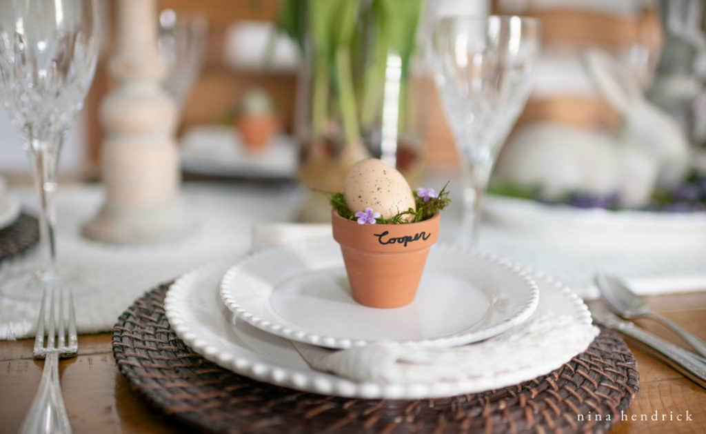 Flower pot nests favor ideas for a purple spring tablescape.