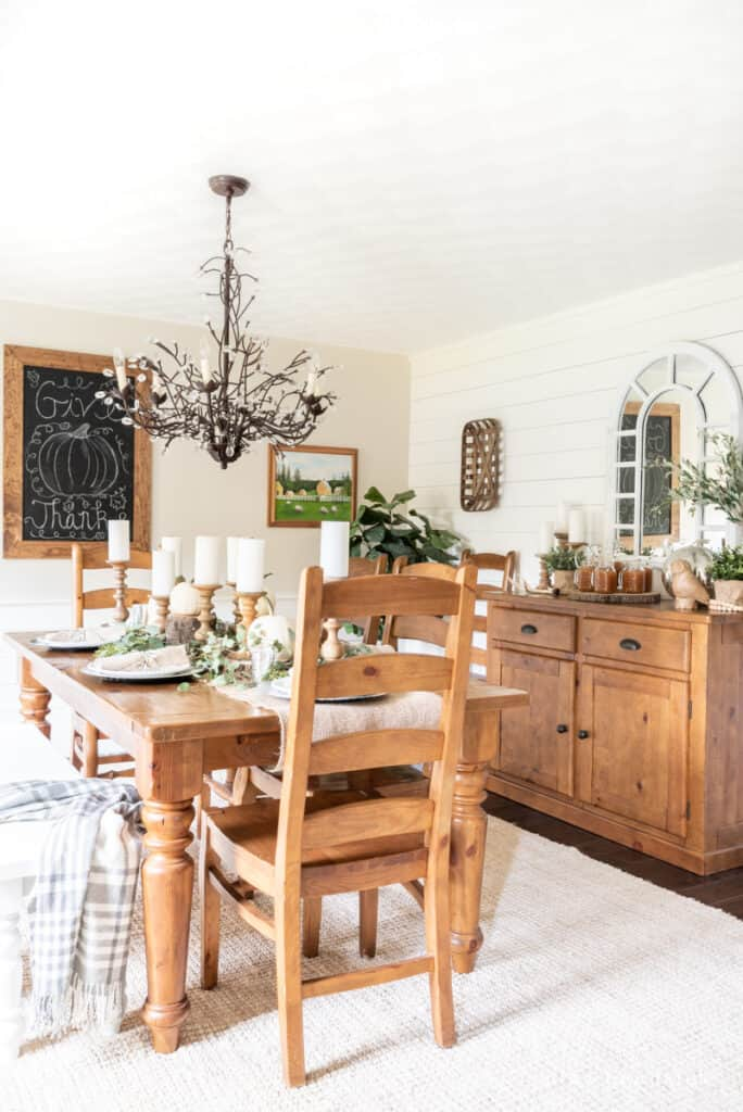 rustic Thanksgiving dining room with warm wood tones and a tablescape