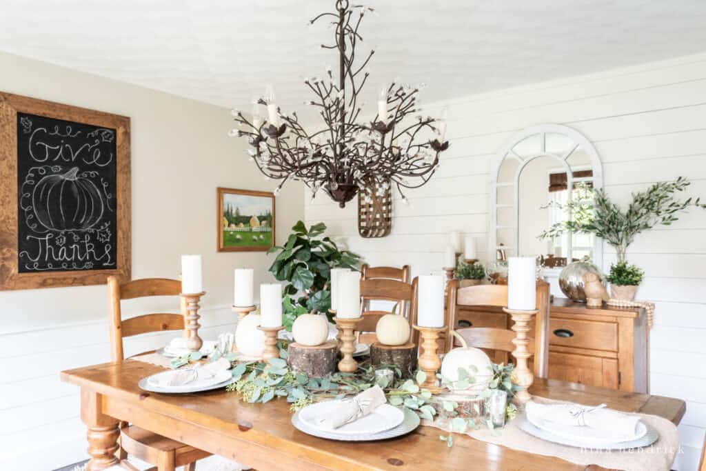 Rustic Thanksgiving celebration in the dining room with white shiplap walls