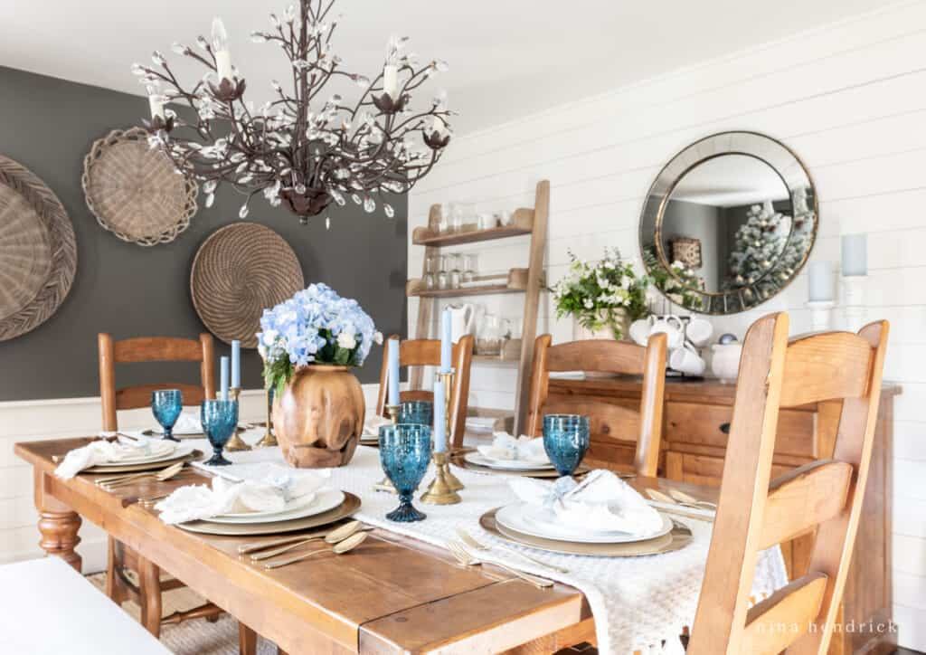 Blue tablescape for Christmas with hydrangeas and colbalt glassware