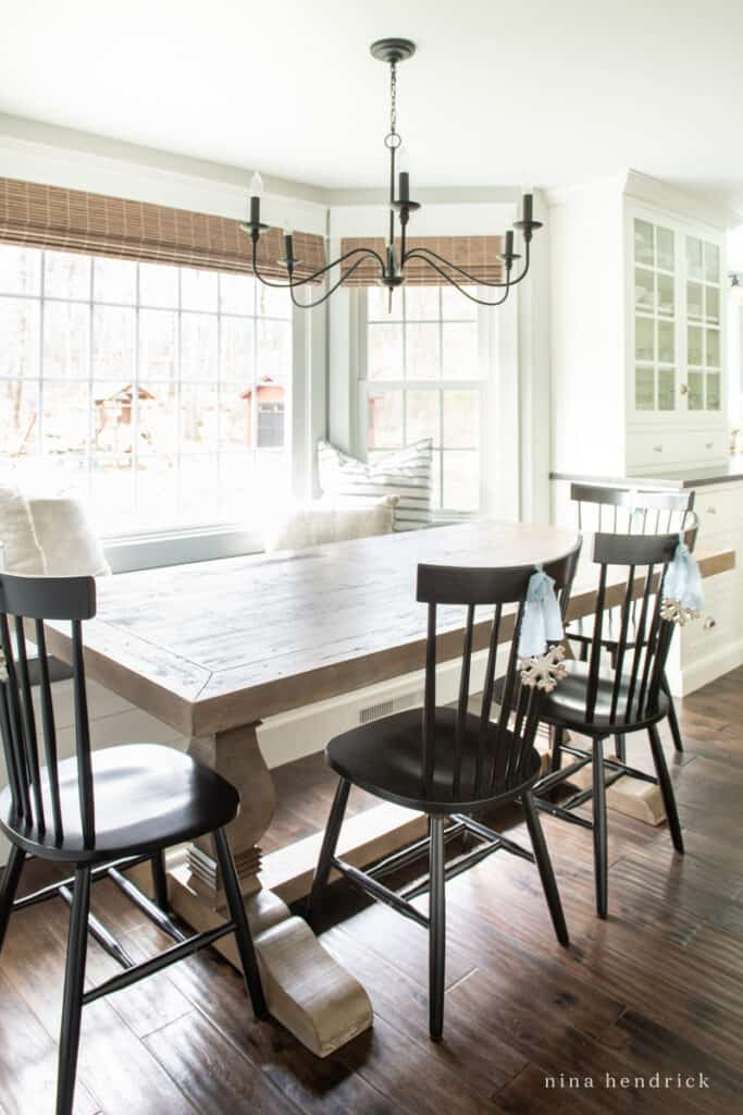 Breakfast Nook with windows and ornaments on black chairs | Nina Hendrick Home