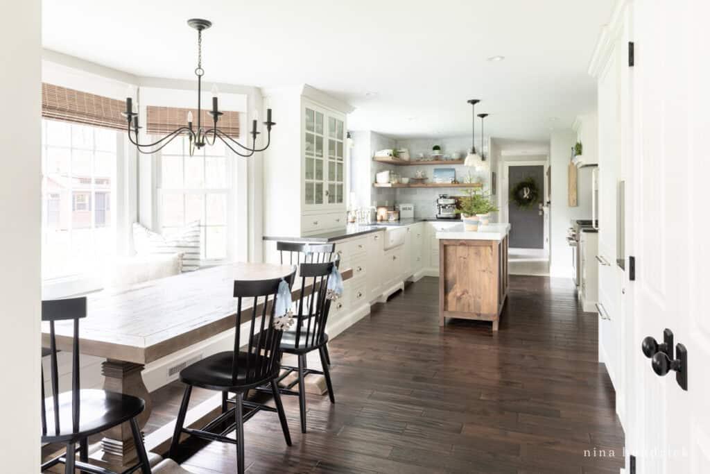 blue Christmas Kitchen decor with Dark wood floors and bright windows | Nina Hendrick Home