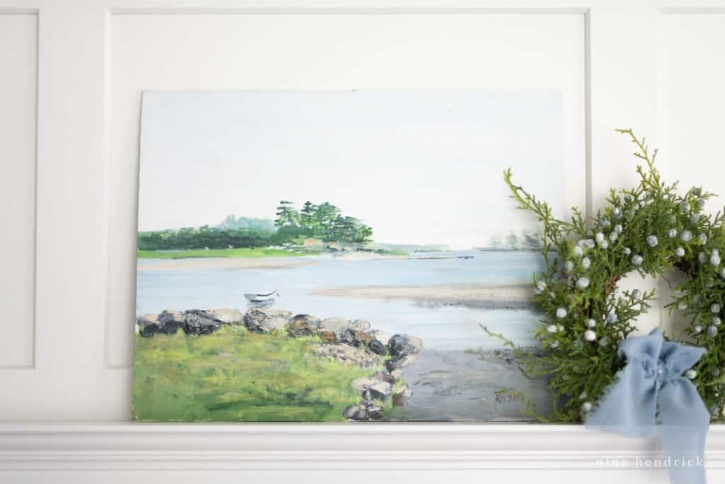 Coastal oil painting with wreath and blue ribbon | Nina Hendrick Home