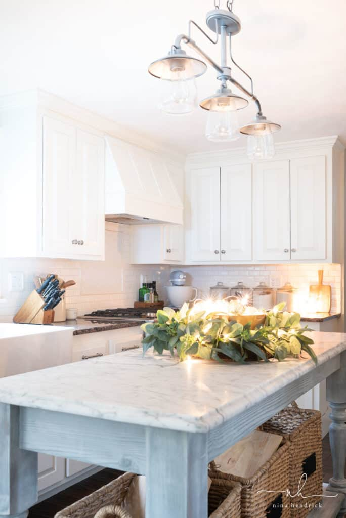 Simple Christmas Kitchen | Decorate your kitchen for Christmas with simple greenery, wooden touches, and pretty golden lights for a classic but elegant theme.